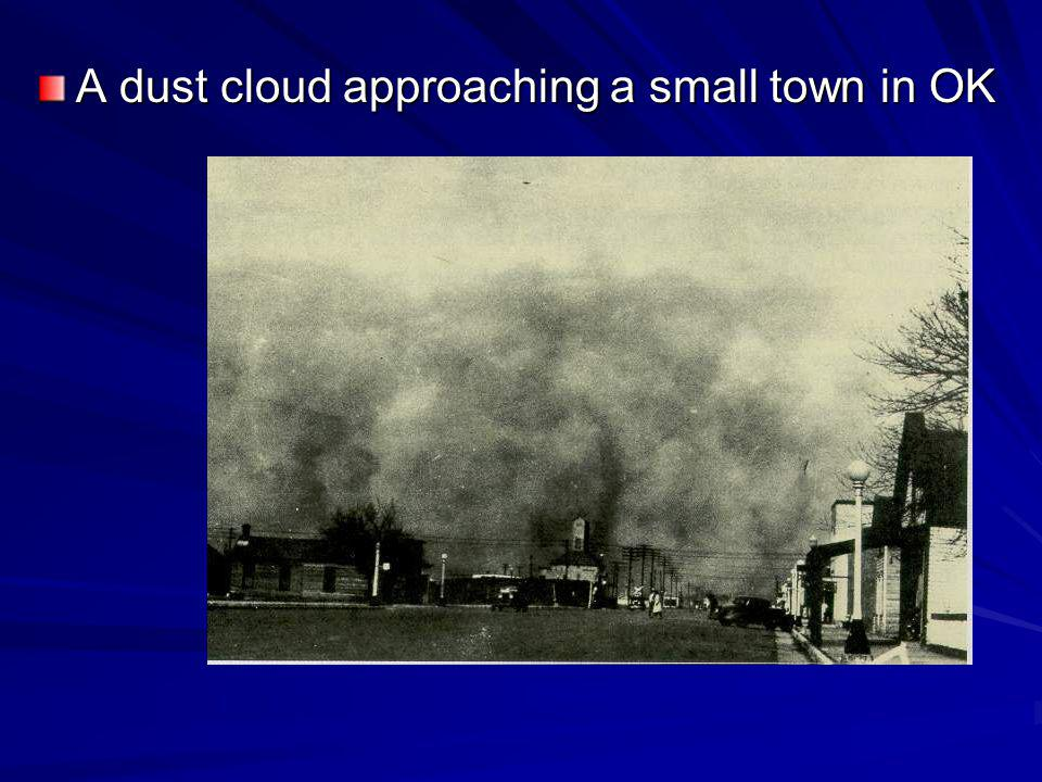 A dust cloud approaching a small town in OK
