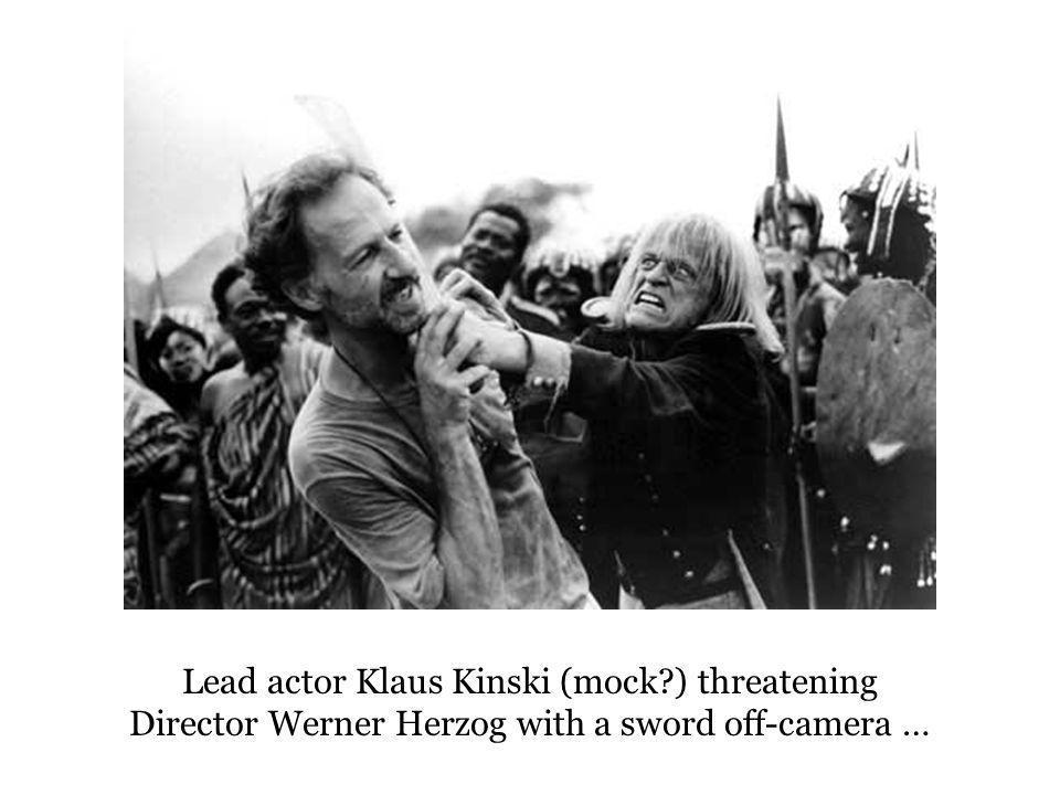Lead actor Klaus Kinski (mock?) threatening Director Werner Herzog with a sword off-camera …