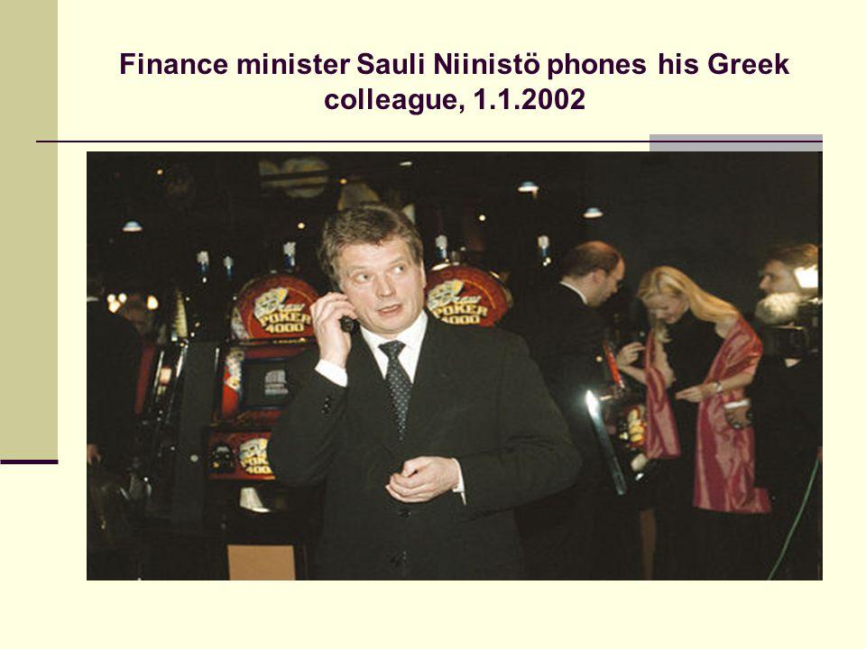 Finance minister Sauli Niinistö phones his Greek colleague, 1.1.2002
