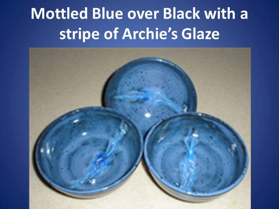 Mottled Blue over Black with a stripe of Archies Glaze