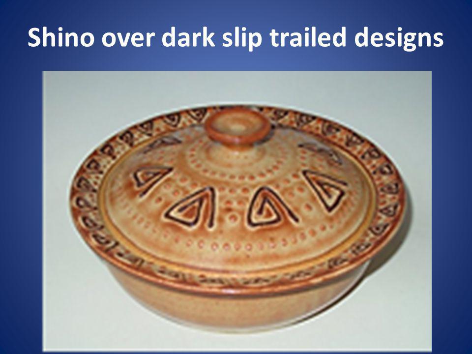 Shino over dark slip trailed designs