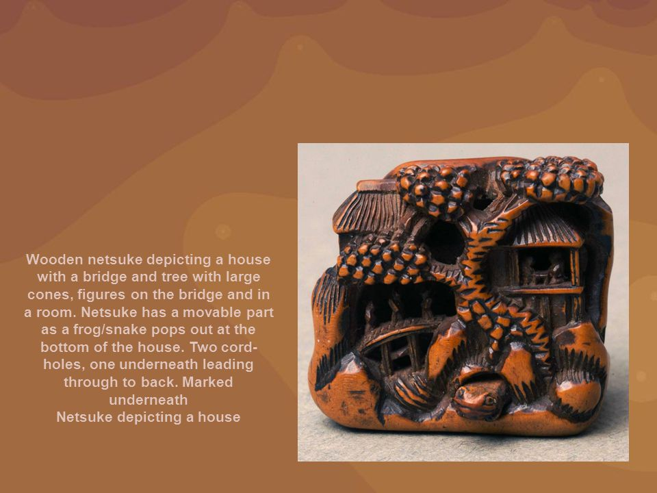 Wooden netsuke depicting a house with a bridge and tree with large cones, figures on the bridge and in a room. Netsuke has a movable part as a frog/sn