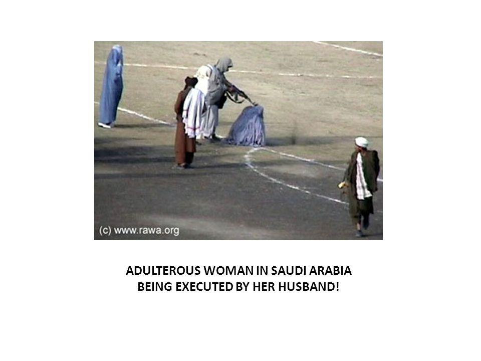 ADULTEROUS WOMAN IN SAUDI ARABIA BEING EXECUTED BY HER HUSBAND!