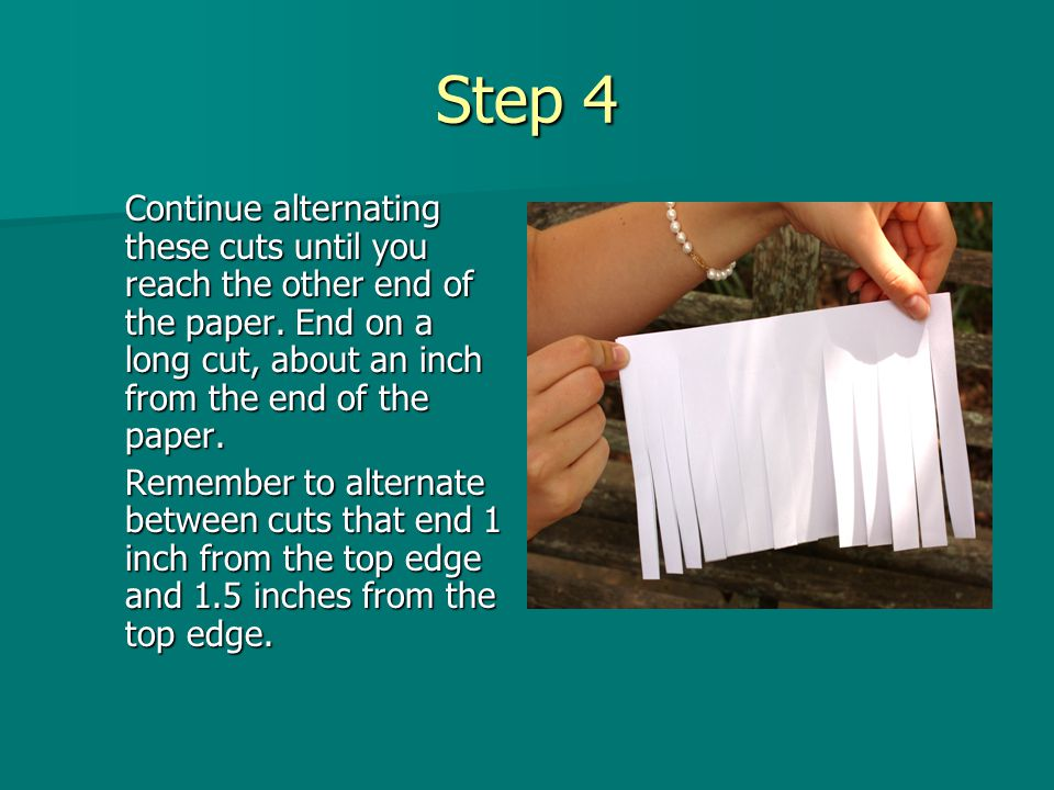 Step 4 Continue alternating these cuts until you reach the other end of the paper. End on a long cut, about an inch from the end of the paper. Remembe