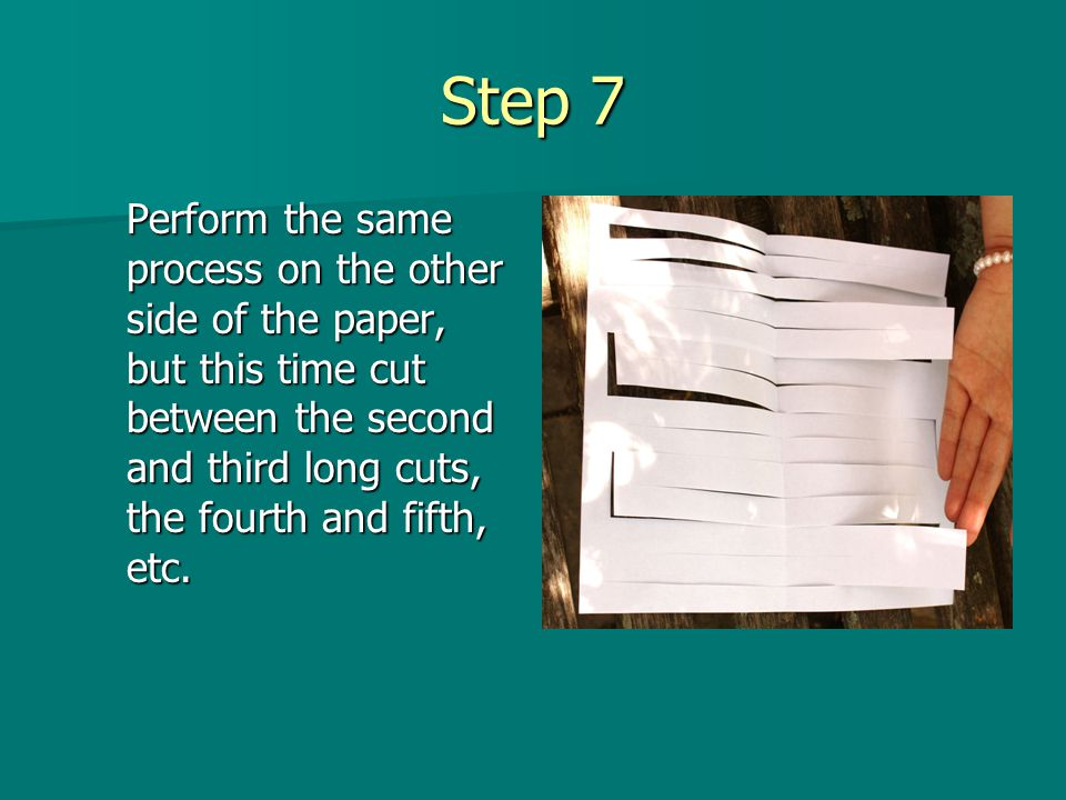 Step 8 On both sides of the paper, cut from the edge of the paper to the shorter cuts you made earlier.