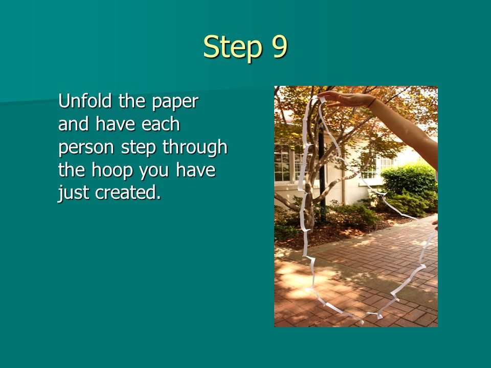 Step 9 Unfold the paper and have each person step through the hoop you have just created.