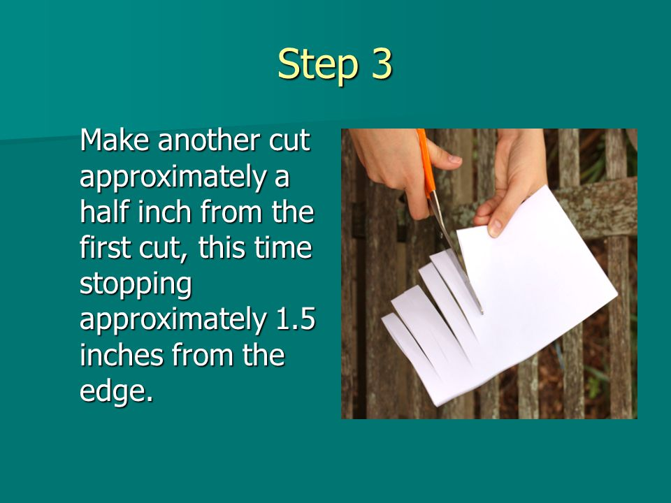 Step 4 Continue alternating these cuts until you reach the other end of the paper.