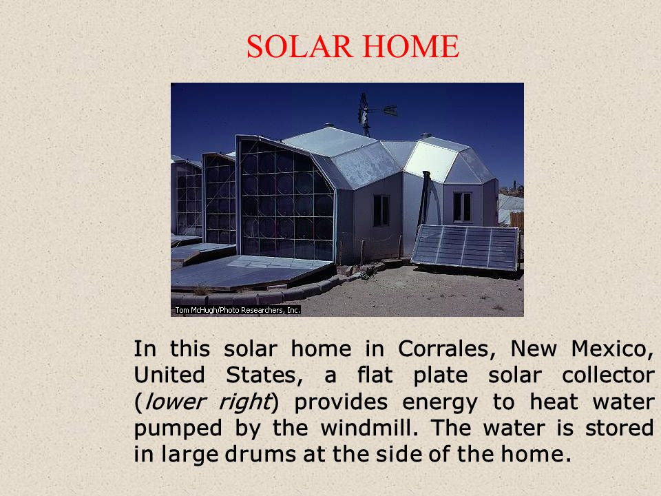 In this solar home in Corrales, New Mexico, United States, a flat plate solar collector (lower right) provides energy to heat water pumped by the windmill.