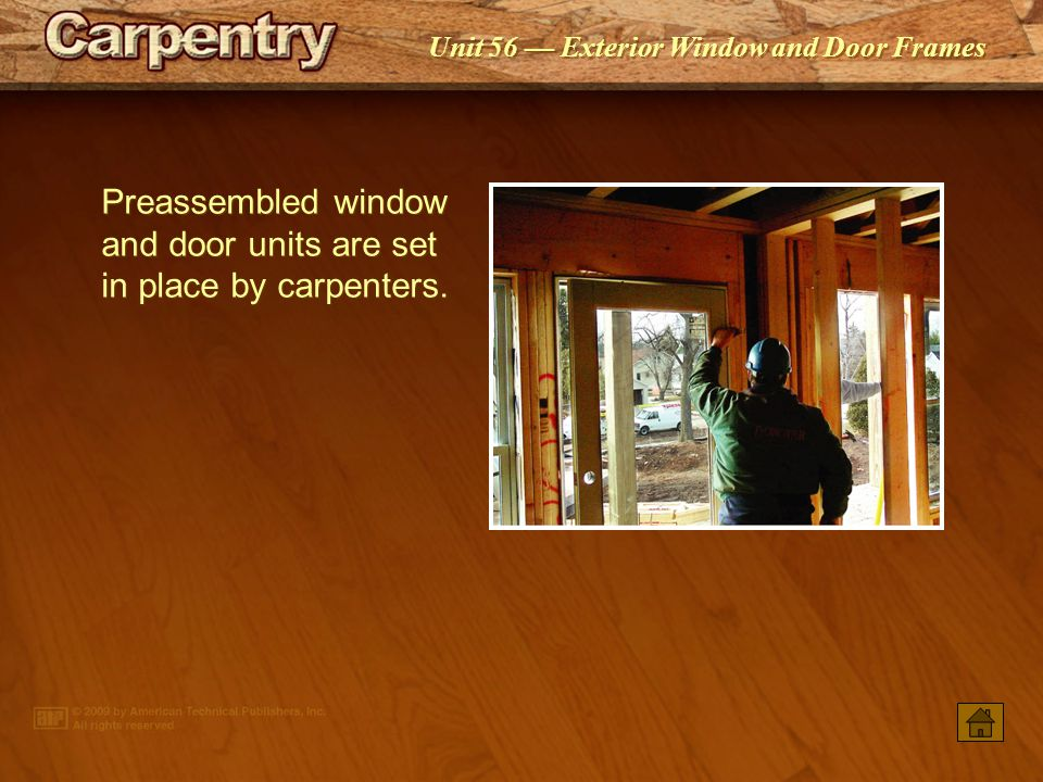 Unit 56 Exterior Window and Door Frames Preassembled window and door units are set in place by carpenters.