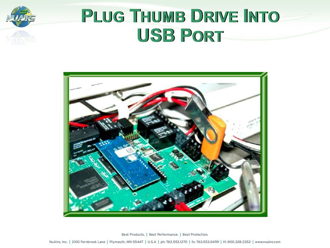 P LUG T HUMB D RIVE I NTO USB P ORT P LUG T HUMB D RIVE I NTO USB P ORT