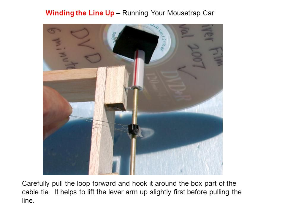 Carefully pull the loop forward and hook it around the box part of the cable tie. It helps to lift the lever arm up slightly first before pulling the