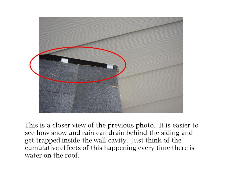 In this photo, there is no kick-out flashing at the roof-to- wall connection. Without the flashing, water is allowed to drain behind the siding. This