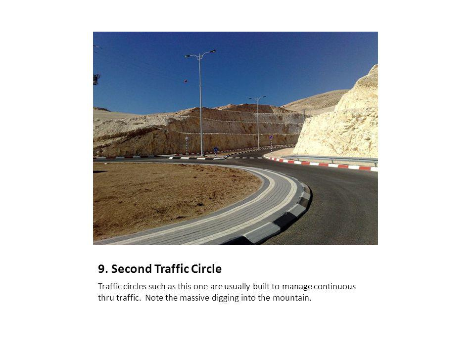 9. Second Traffic Circle Traffic circles such as this one are usually built to manage continuous thru traffic. Note the massive digging into the mount