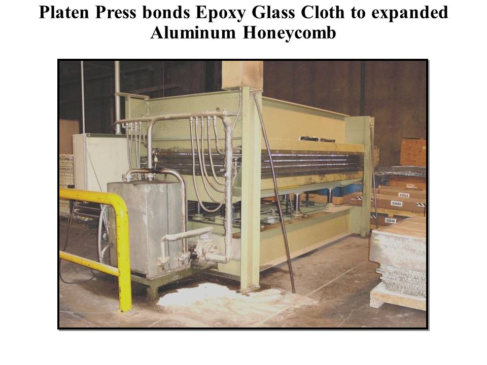 Platen Press bonds Epoxy Glass Cloth to expanded Aluminum Honeycomb