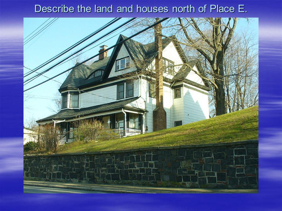 Describe the land and houses north of Place E.