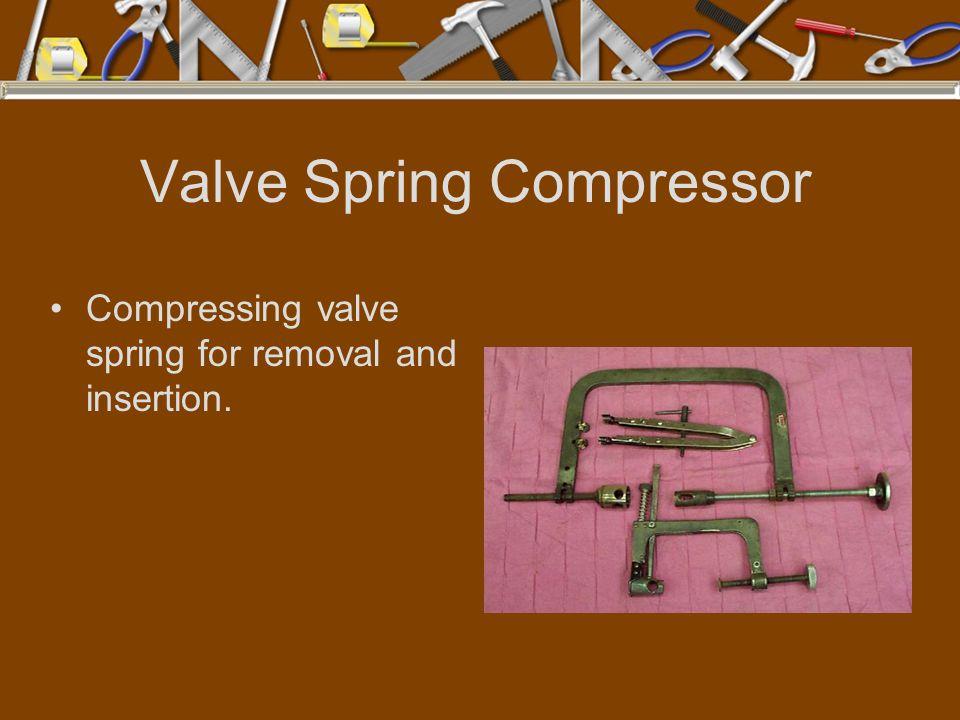 Valve Spring Compressor Compressing valve spring for removal and insertion.