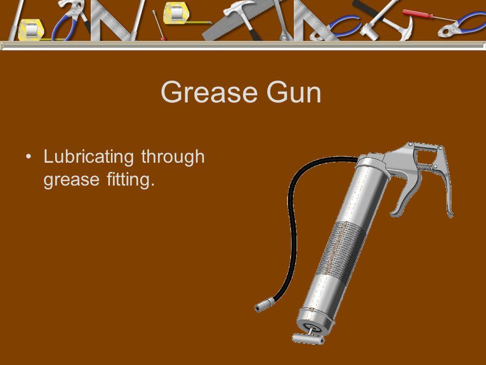 Grease Gun Lubricating through grease fitting.