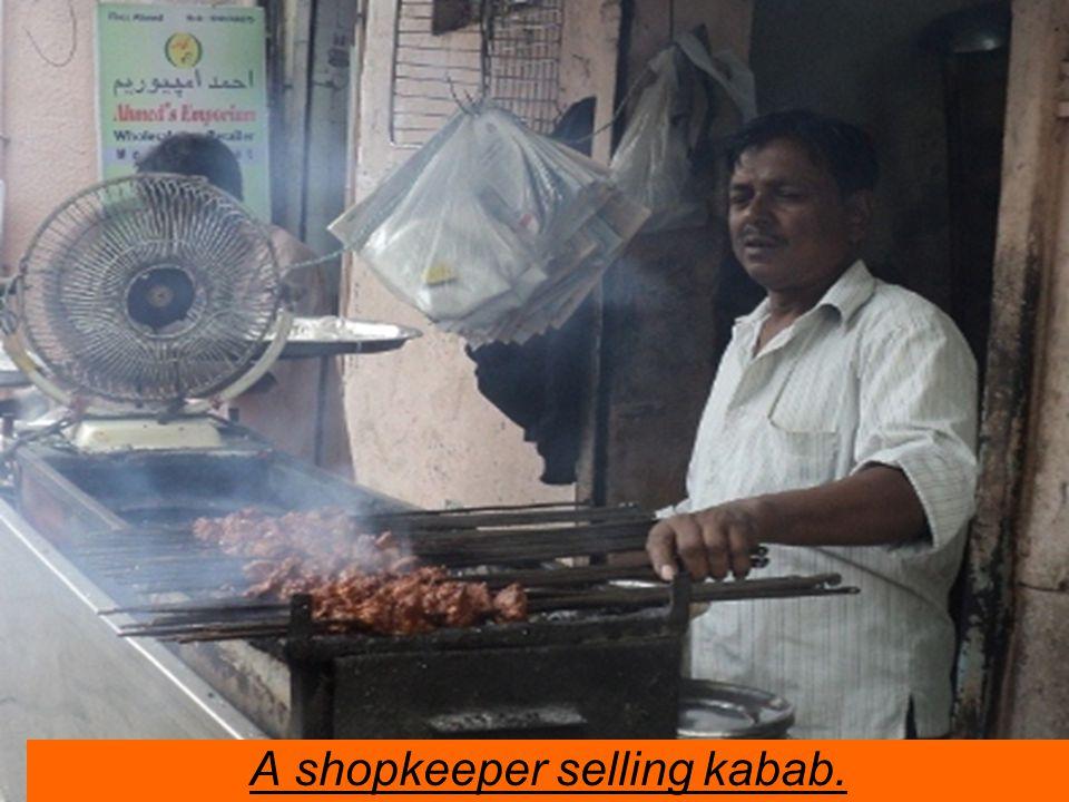 A shopkeeper selling kabab.
