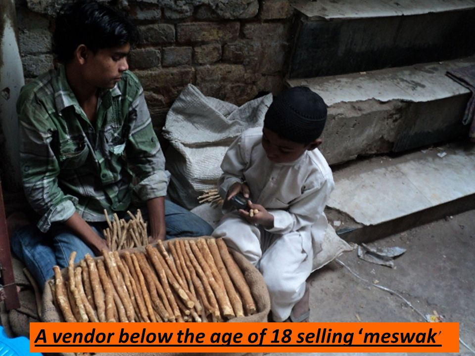 A vendor below the age of 18 selling meswak