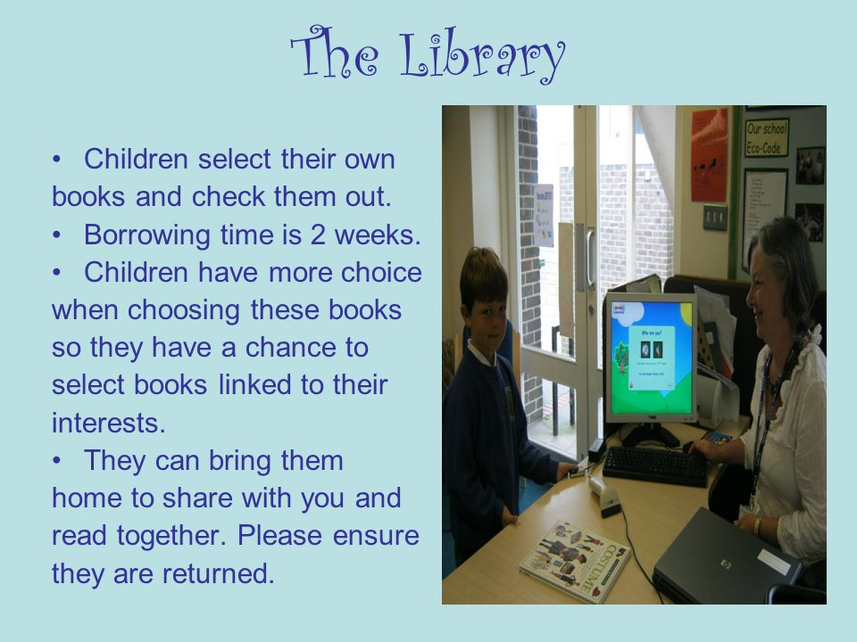 The Library Children select their own books and check them out.
