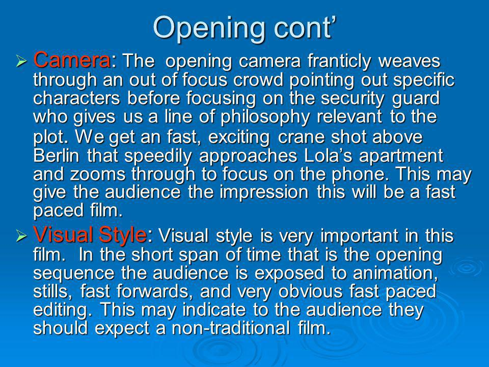 Opening cont Camera: The opening camera franticly weaves through an out of focus crowd pointing out specific characters before focusing on the securit