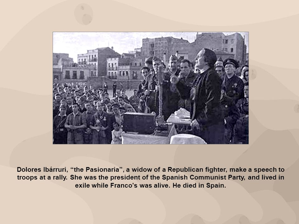 Dolores Ibárruri, the Pasionaria, a widow of a Republican fighter, make a speech to troops at a rally.