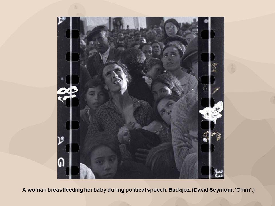 A woman breastfeeding her baby during political speech. Badajoz. (David Seymour, 'Chim'.)