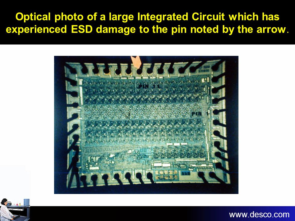 Optical photo of a large Integrated Circuit which has experienced ESD damage to the pin noted by the arrow. www.desco.com