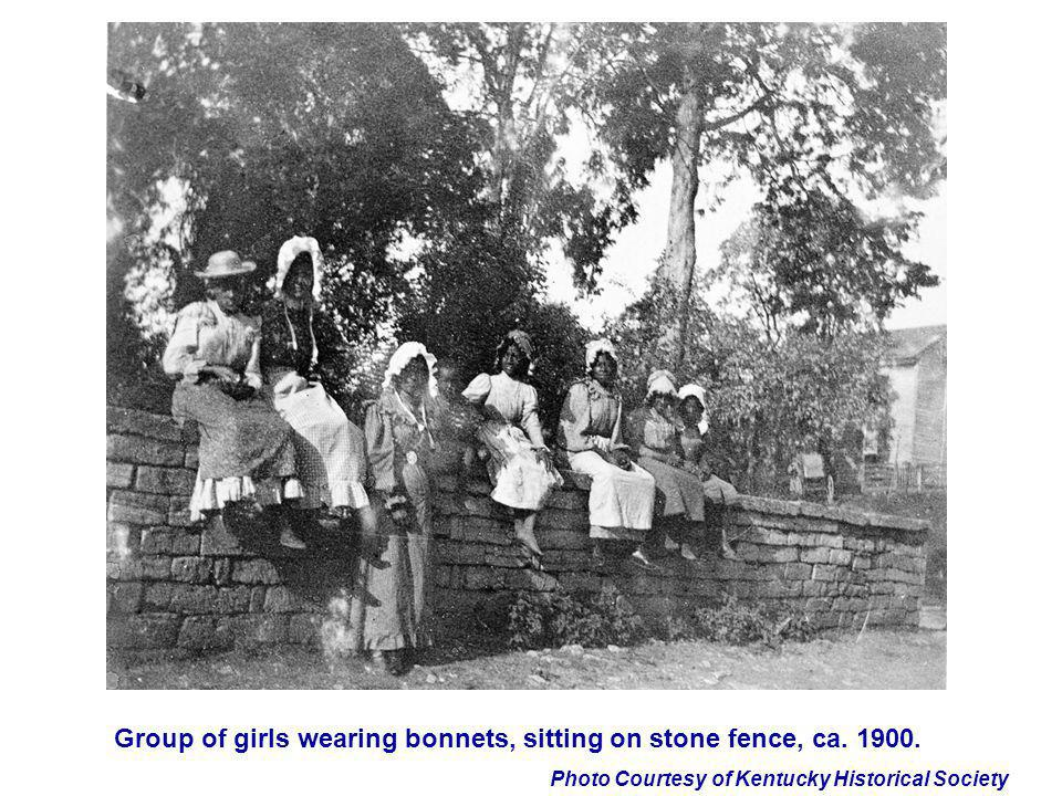 Photo Courtesy of Kentucky Historical Society Group of girls wearing bonnets, sitting on stone fence, ca. 1900.