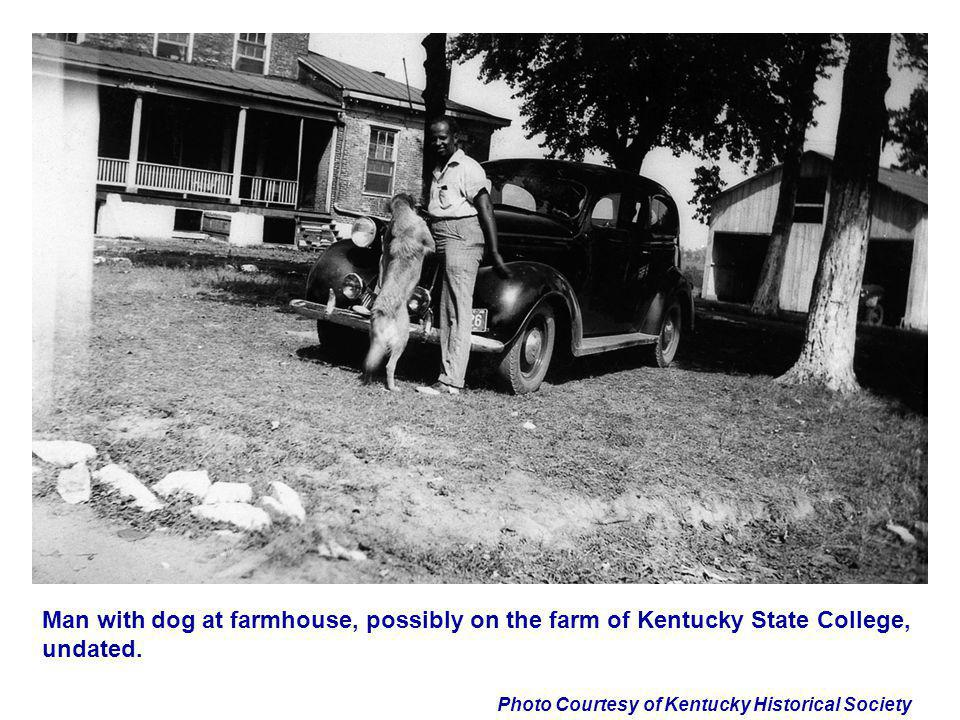 Photo Courtesy of Kentucky Historical Society Man with dog at farmhouse, possibly on the farm of Kentucky State College, undated.