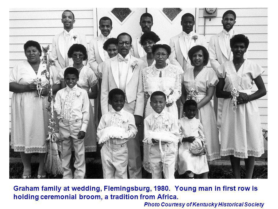 Photo Courtesy of Kentucky Historical Society Graham family at wedding, Flemingsburg, 1980. Young man in first row is holding ceremonial broom, a trad