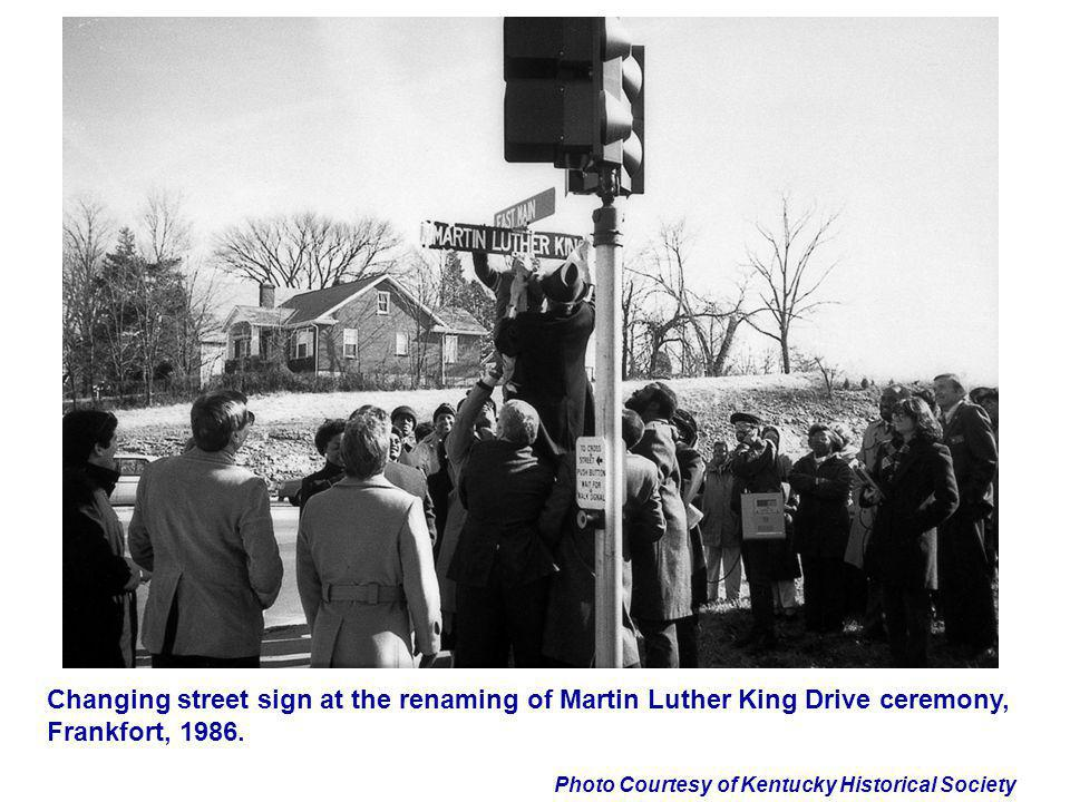 Photo Courtesy of Kentucky Historical Society Changing street sign at the renaming of Martin Luther King Drive ceremony, Frankfort, 1986.