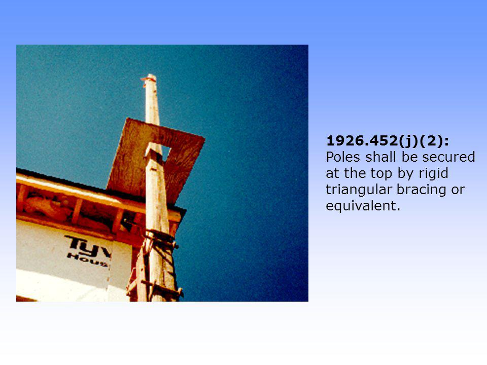 1926.452(j)(3): When work benches are used for fall protection, they must meet requirements of 1926.451(g): No violation: No midrail is needed because gap between platforms is 23 inches.