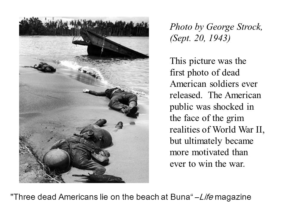 Three dead Americans lie on the beach at Buna –Life magazine Photo by George Strock, (Sept.