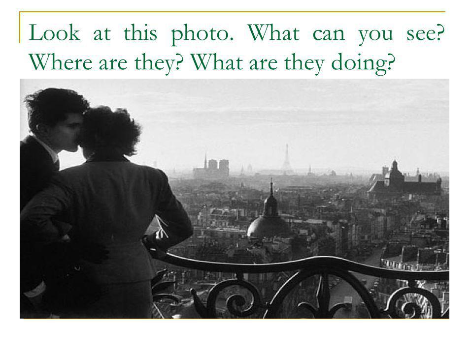 Look at this photo. What can you see? Where are they? What are they doing?