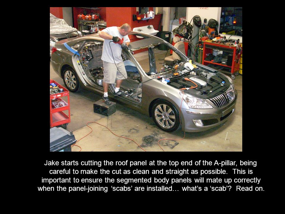 After a careful review of the inner body panels, tape marks are placed along the areas where a reciprocating power saw will be used to segment the car as needed.