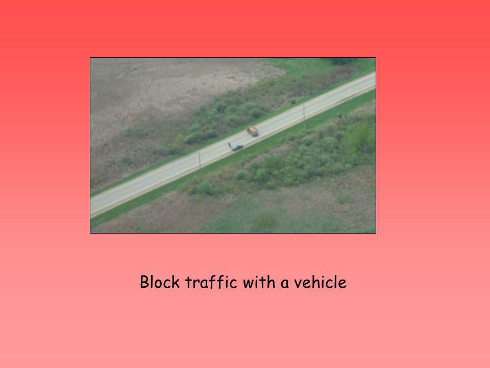 Block traffic with a vehicle