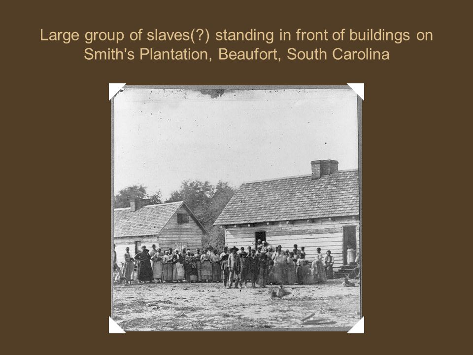 Large group of slaves( ) standing in front of buildings on Smith s Plantation, Beaufort, South Carolina