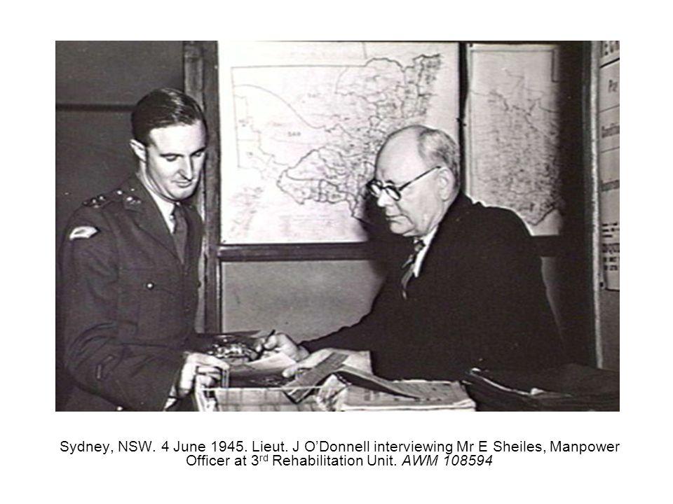 Sydney, NSW. 4 June 1945. Lieut. J ODonnell interviewing Mr E Sheiles, Manpower Officer at 3 rd Rehabilitation Unit. AWM 108594