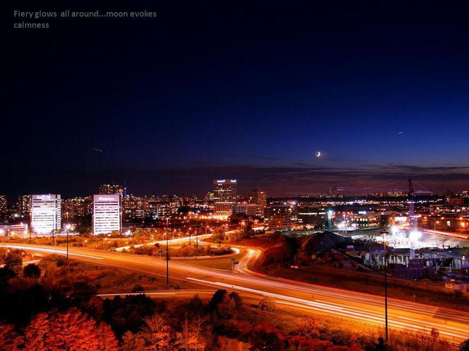 Fiery glows all around...moon evokes calmness
