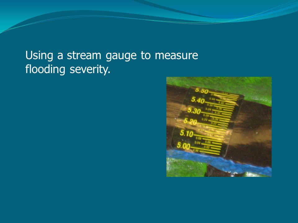 Using a stream gauge to measure flooding severity.