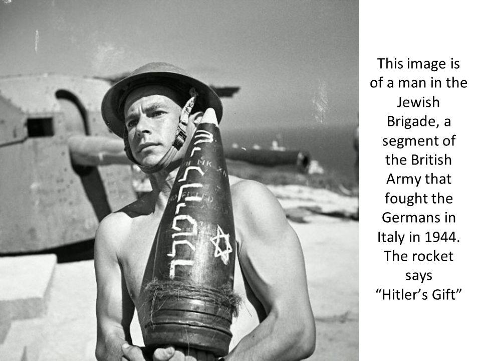 This image is of a man in the Jewish Brigade, a segment of the British Army that fought the Germans in Italy in 1944. The rocket says Hitlers Gift