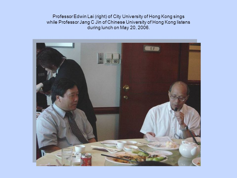 Professor Edwin Lai (right) of City University of Hong Kong sings while Professor Jang C Jin of Chinese University of Hong Kong listens during lunch on May 20, 2006.