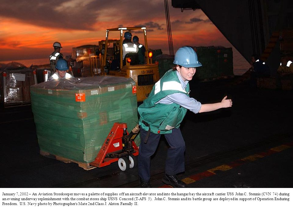 January 7, 2002 – An Aviation Storekeeper moves a palette of supplies off an aircraft elevator and into the hangar bay the aircraft carrier USS John C.