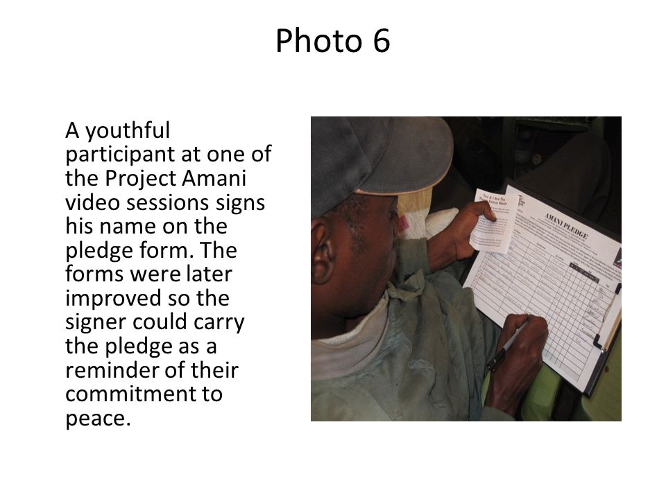Photo 6 A youthful participant at one of the Project Amani video sessions signs his name on the pledge form. The forms were later improved so the sign