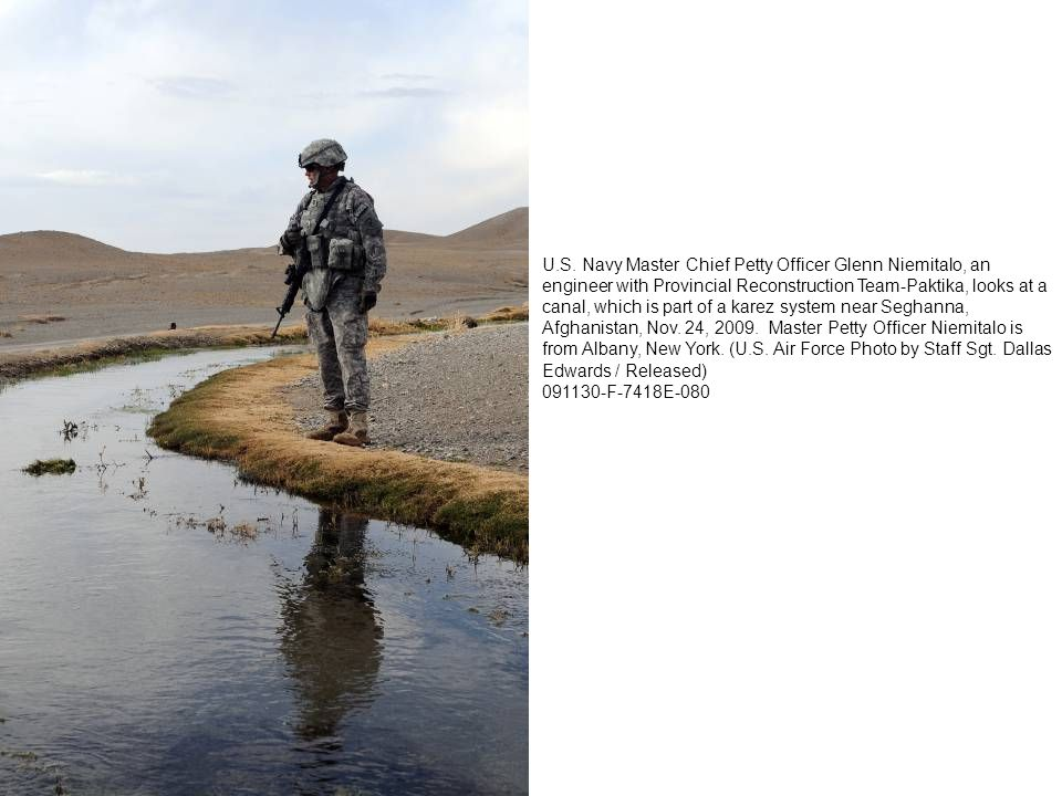 U.S. Navy Master Chief Petty Officer Glenn Niemitalo, an engineer with Provincial Reconstruction Team-Paktika, looks at a canal, which is part of a ka