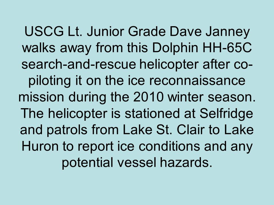 USCG Lt. Junior Grade Dave Janney walks away from this Dolphin HH-65C search-and-rescue helicopter after co- piloting it on the ice reconnaissance mis