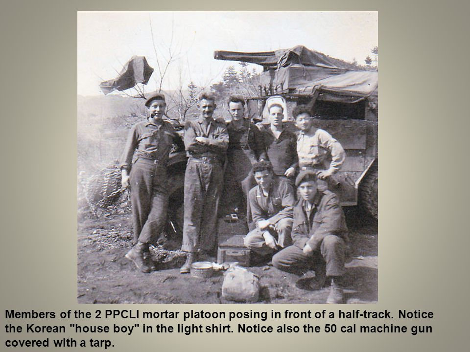 Members of the 2 PPCLI mortar platoon posing in front of a half-track. Notice the Korean