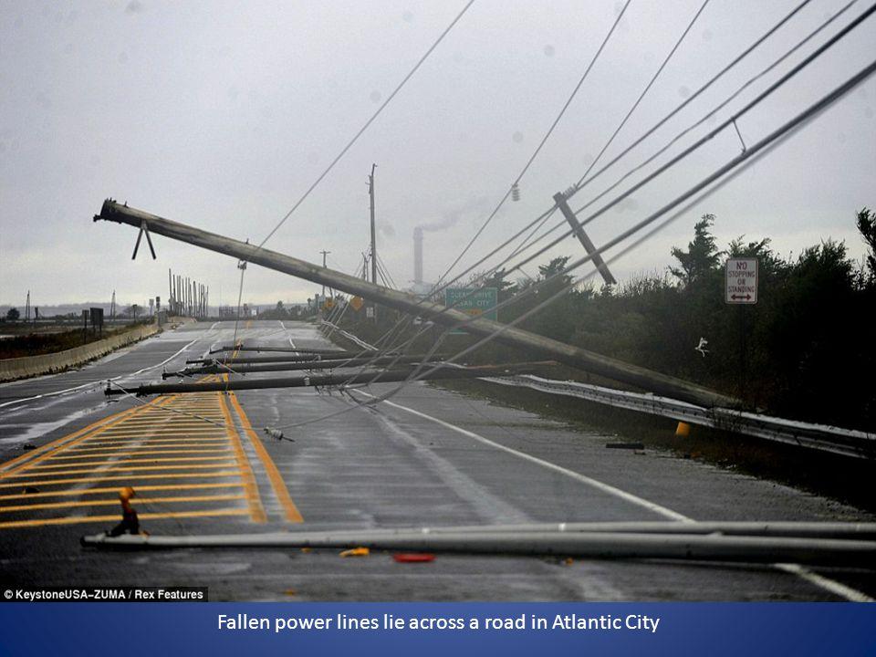 Fallen power lines lie across a road in Atlantic City