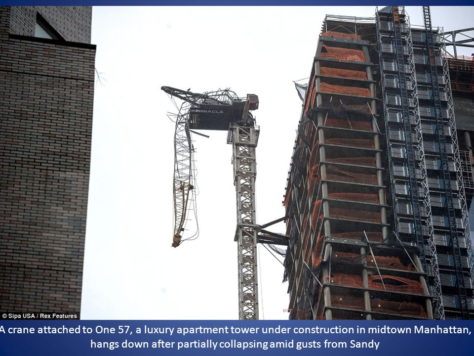 A crane attached to One 57, a luxury apartment tower under construction in midtown Manhattan, hangs down after partially collapsing amid gusts from Sandy